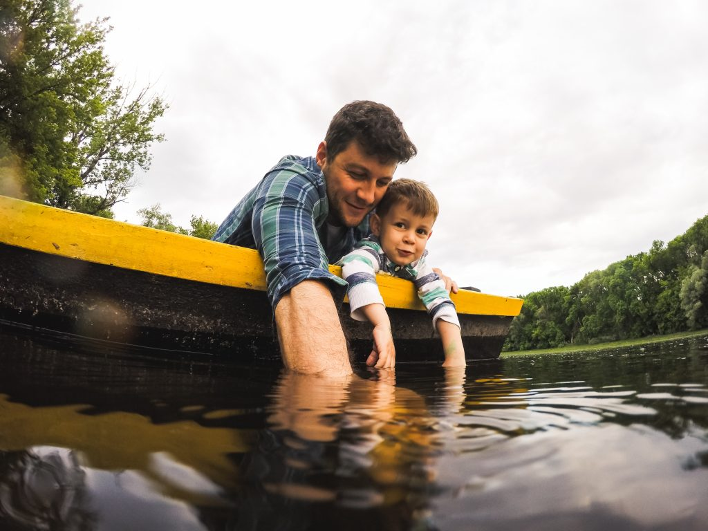 Shot of a father and son enjoying a boat ride together on a lake